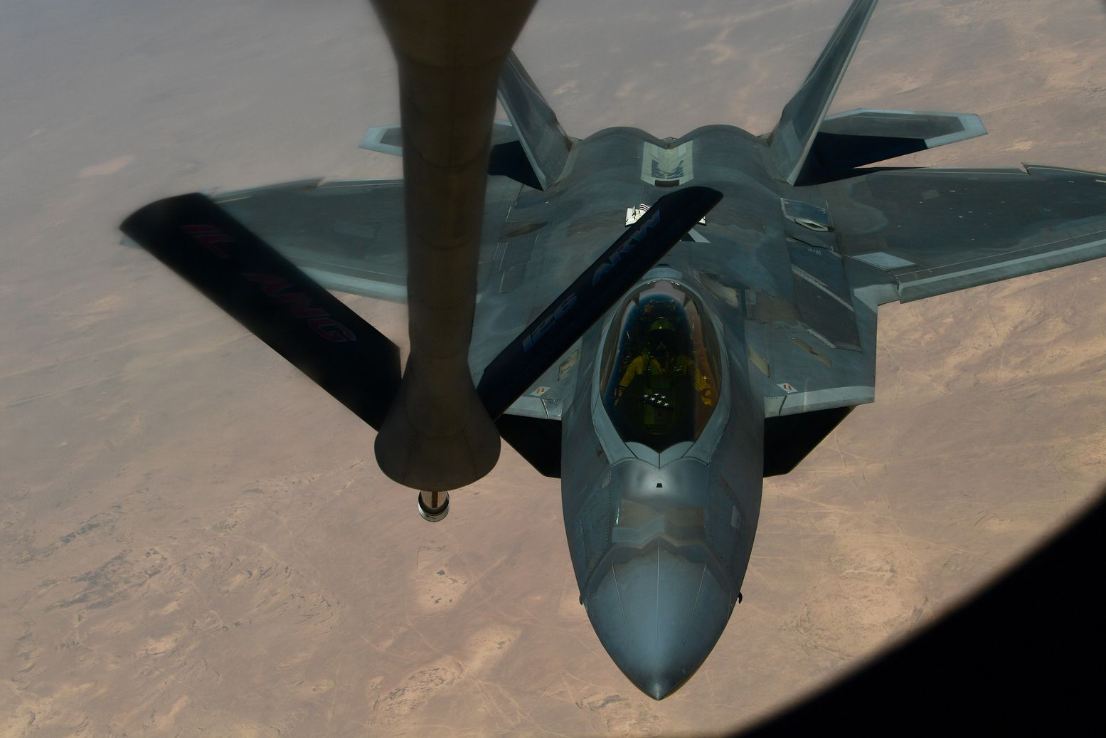 A F-22 Raptor Snuck Right Underneath an Iranian Fighter Jet