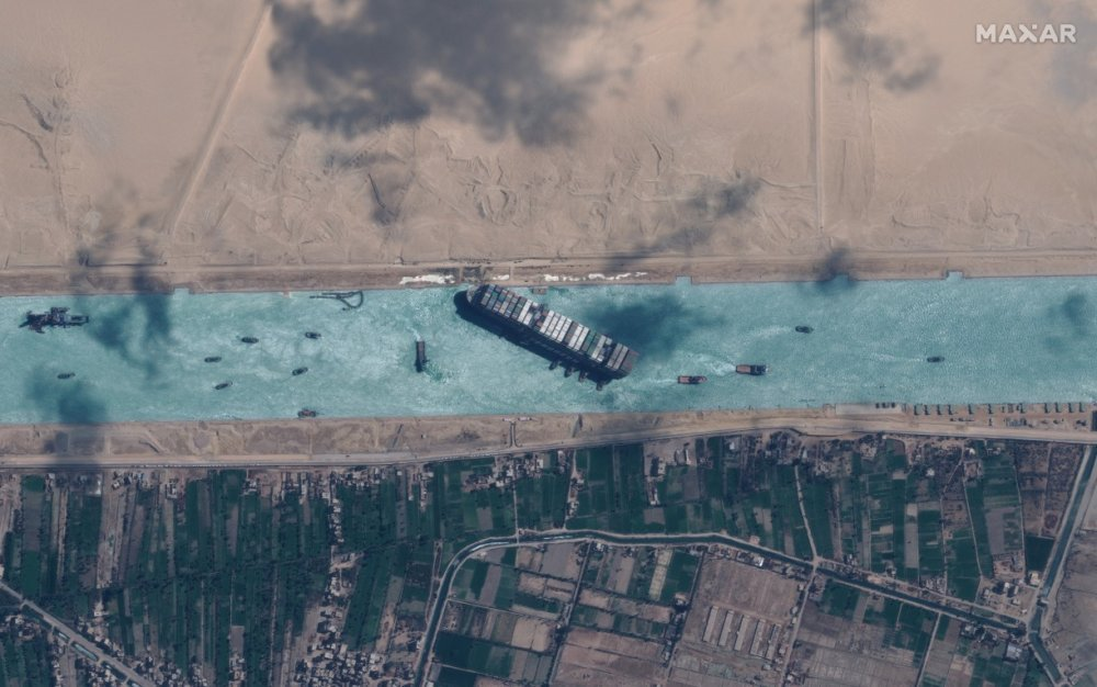This image has an empty alt attribute; its file name is 2021-03-29T152423Z_2011726512_RC23LM97BH7Z_RTRMADP_3_EGYPT-SUEZCANAL-SHIP.JPG.jpg
