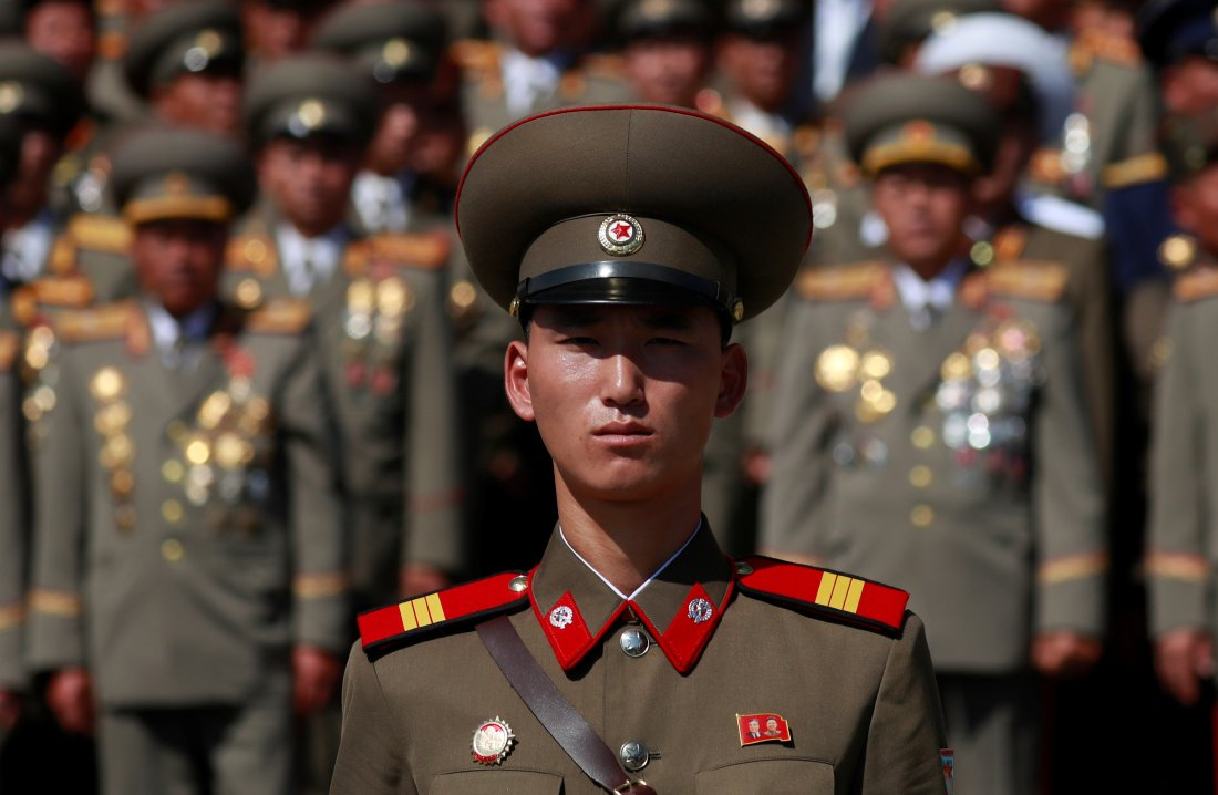 A soldier wears a badge with portraits of late North Korean leaders Kim Il Sung and Kim Jong Il as he attends a military parade marking the 70th anniversary of North Korea's foundation in Pyongyang, North Korea, September 9, 2018. REUTERS/Danish Siddiqui