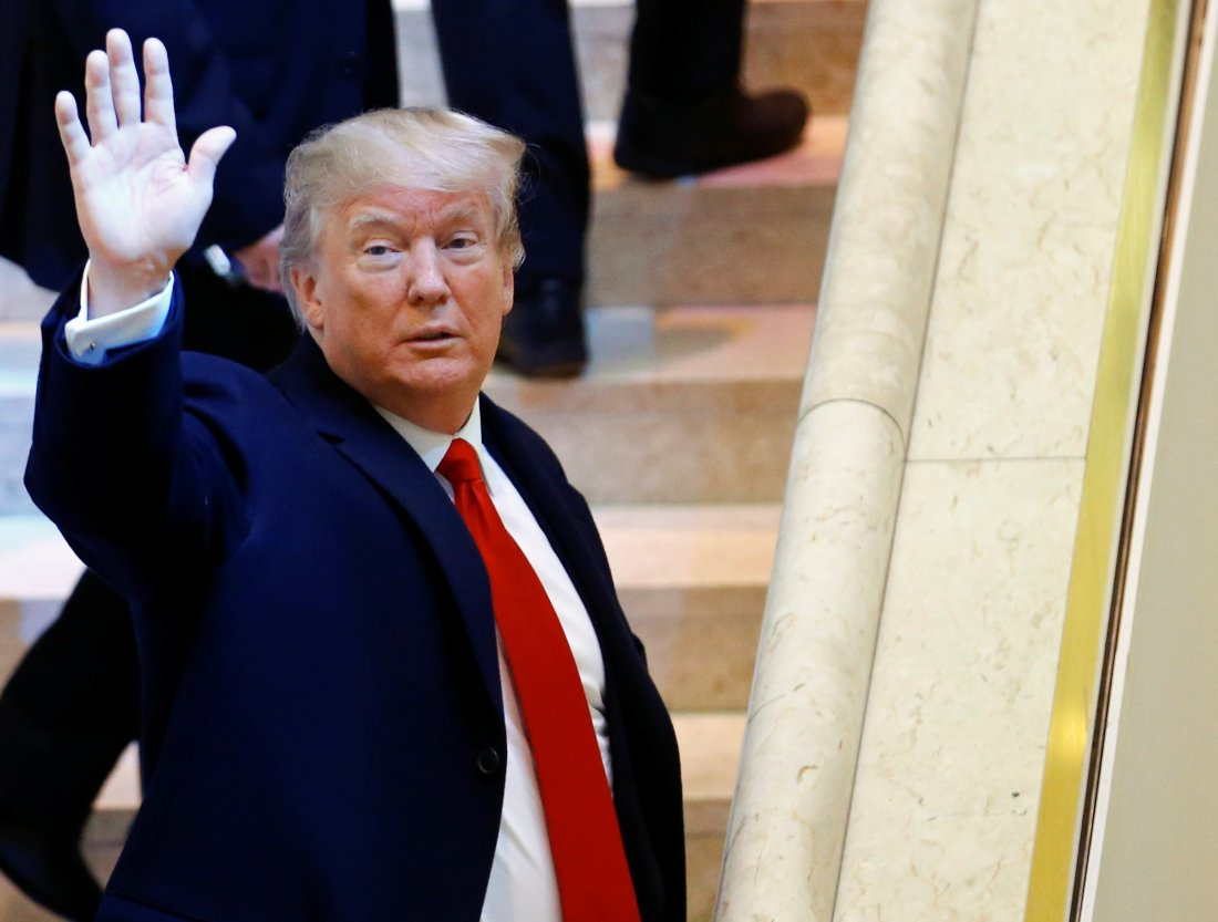 U.S. President Donald Trump waves as he arrives at the World Economic Forum (WEF) annual meeting in Davos, Switzerland January 26, 2018. REUTERS/Denis Balibouse