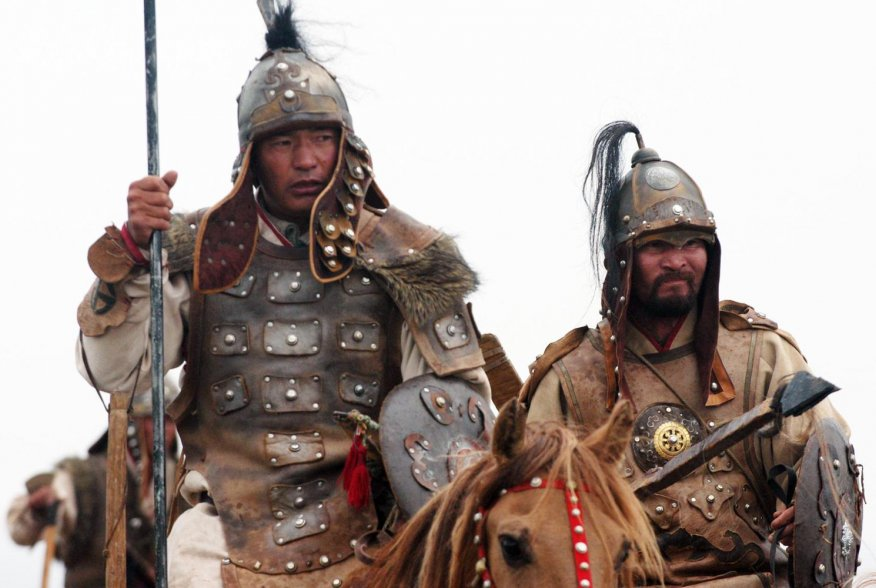 Horse-mounted members of the Mongolian Armed Forces honor their warrior heritage during the opening ceremony of exercise Khaan Quest, Five Hills Training Center, Mongolia. 1 Aug 2007. (Official U. S. Marine Corps photo by Sgt. G. S. Thomas)