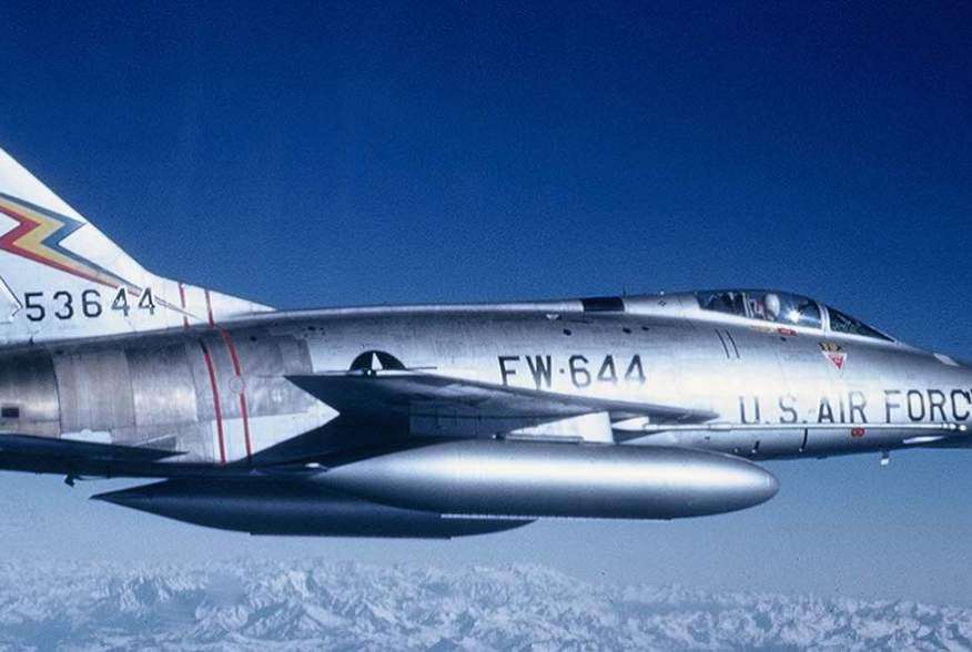 "In 1962, the 20th Fighter Bomber Wing reequipped with North American F-100 Super Sabres like this one, much better suited for the nuclear ""toss bombing"" mission due to their greater power and speed."