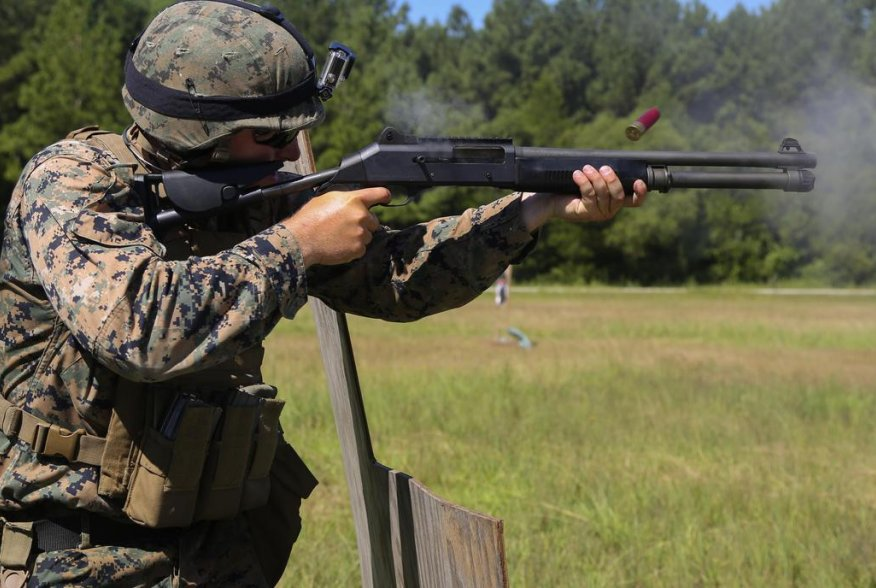 Sgt. James Jackson, Stone Bay alpha range line staff, fires a Benelli M4 shotgun at a target during a Combat Marksmanship Trainer Course at Camp Lejeune. Sep. 15, 2018. (U.S. Marine Corps photo by Cpl. Mark Watola /Released)
