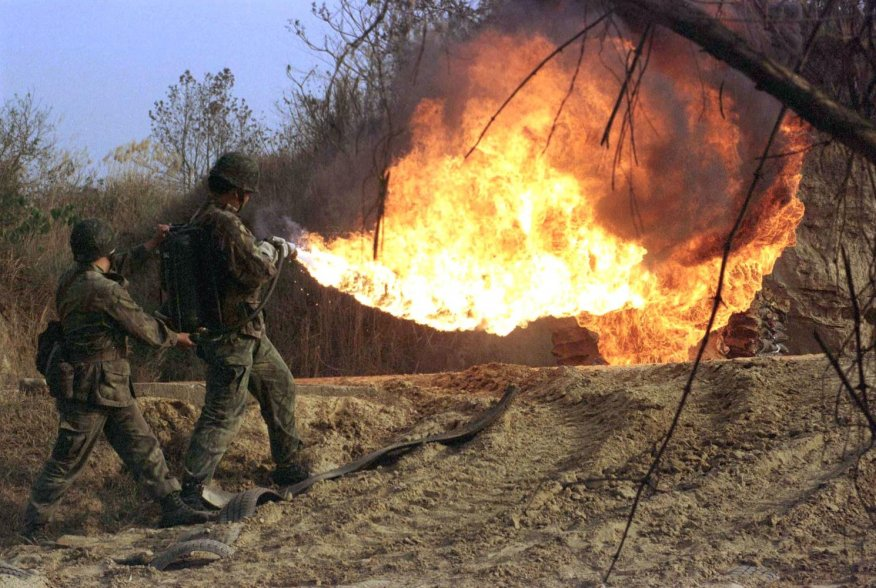 Taiwanese soldiers use flamethrowers during a practice drill at a military base in the southern county of Chiayi January 30. The armed forces here usually step up training before the Chinese lunar new year which falls on February 7 to increase their comba