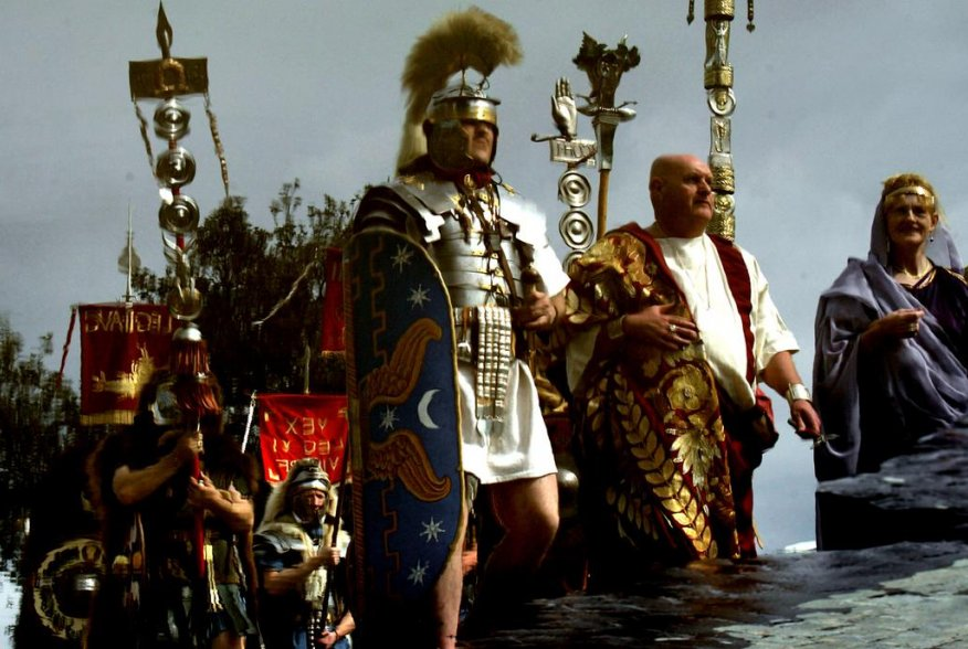 Englishmen from Newcastle, dressed as ancient Romans of the II Augusta Roman Legion, are reflected in a puddle as they march during a parade in Rome April 18, 2004. REUTERS/Max Rossi MR/CRB