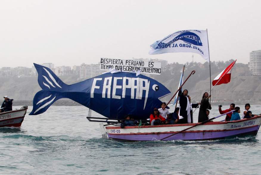 Members of FREPAP, a religious and political movement, take part in the Saint Peter festival in the fishing town of Chorrillos June 29, 2010. Devotees of Saint Peter, the patron saint of fishermen, took part in the celebrations in the hope of good catches