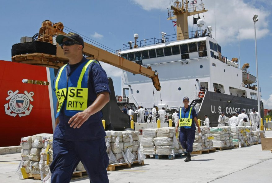 Crew members from the U.S. Coast Guard Cutter Oak unload 15,000 pounds (6,804 kg) of cocaine worth more than $180 million at Base Support Unit Miami August 2, 2011. The haul was recovered from a self propelled submersible vessel in the western Caribbean