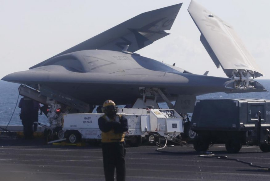 An X-47B pilot-less drone combat aircraft is pictured with its wings folded before being launched for the first time off an aircraft carrier, the USS George H. W. Bush, in the Atlantic Ocean off the coast of Virginia, May 14, 2013. REUTERS/Jason Reed
