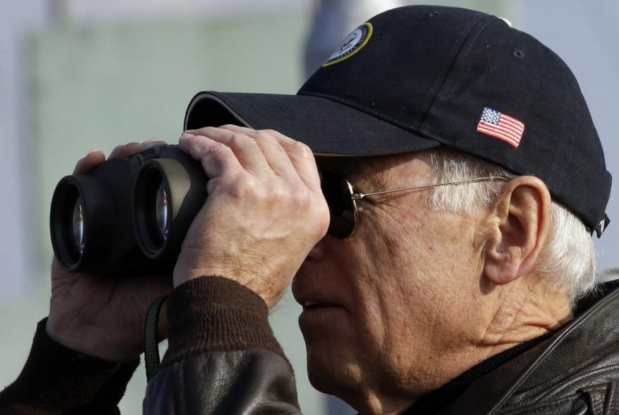 U.S. Vice President Joe Biden looks through binoculars to see North Korea from Observation Post Ouellette during a tour of the Demilitarized Zone (DMZ), the military border separating the two Koreas, in Panmunjom, December 7, 2013. REUTERS/Lee Jin-man/Poo