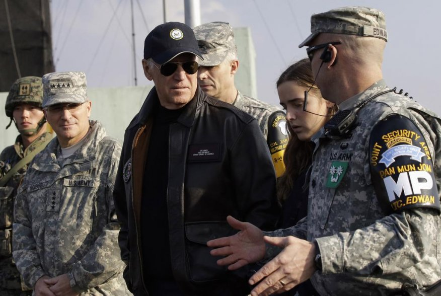 U.S. Vice President Joe Biden (C) is briefed by Lt. Col. Daniel Edwan (R), the commander of the Joint Security Area (JSA) Security Battalion at Observation Post Ouellette, during a tour of the Demilitarized Zone (DMZ), the military border separating the t
