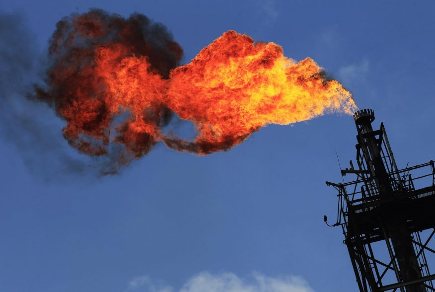 Excess natural gas is being flared, or burnt off, at a flare stack at the refinery in Tula November 21, 2013. REUTERS/Henry Romer