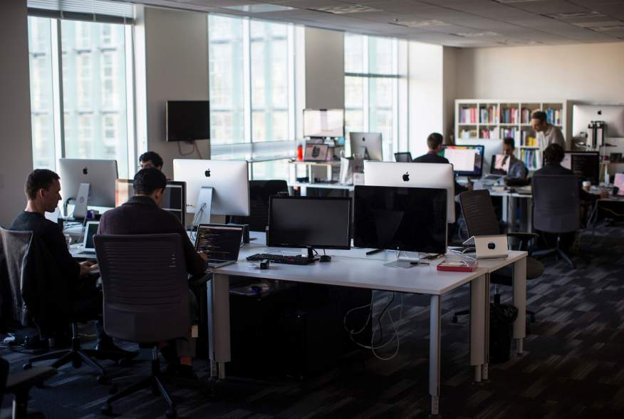 Employees work inside the Minerva Project office in San Francisco, California January 7, 2014.