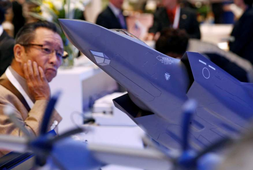 A man looks at a model of Lockheed Martin's F-35 fighter jet during Japan Aerospace 2016 air show in Tokyo, Japan, october 12, 2016. REUTERS/Kim Kyung-Hoon
