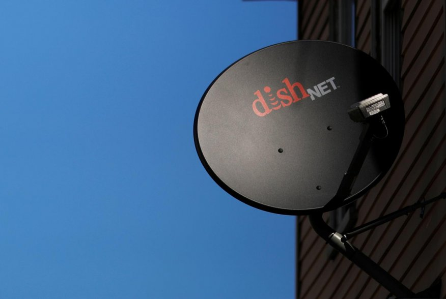 A Dish Network receiver hangs on a house in Somerville, Massachusetts, U.S., February 21, 2017. REUTERS/Brian Snyder