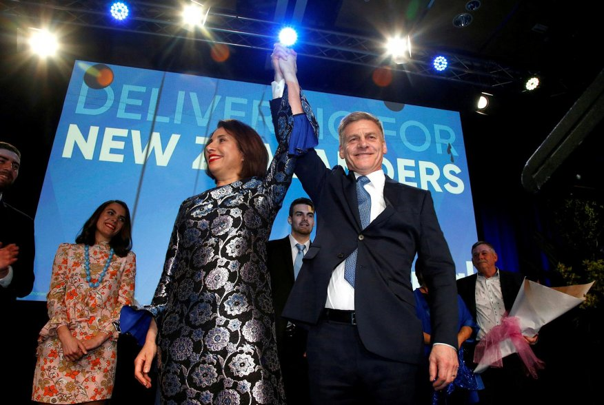 New Zealand Prime Minister Bill English and his wife Mary react on stage alongside family members during an election night event in Auckland, New Zealand, September 23, 2017. REUTERS/Nigel Marple