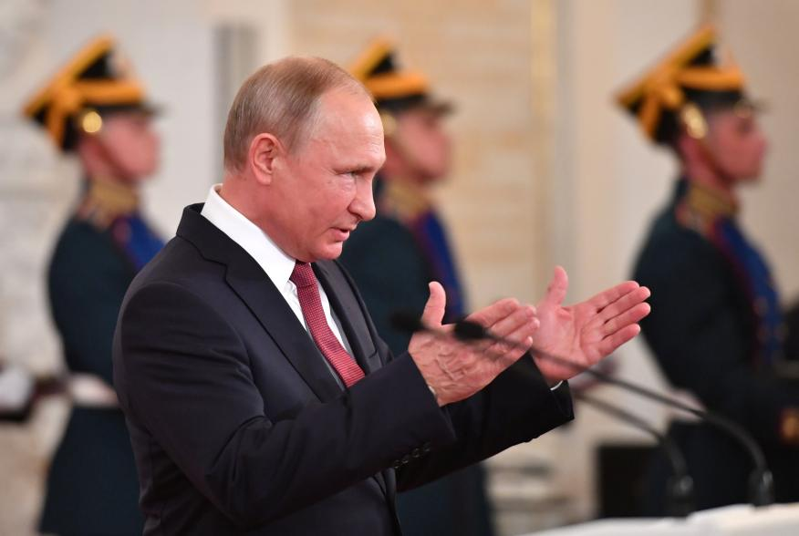 Russian President Vladimir Putin attends an awarding ceremony, marking the Day of Russia, at the Kremlin in Moscow, Russia June 12, 2018. Yuri Kadobnov/Pool via REUTERS