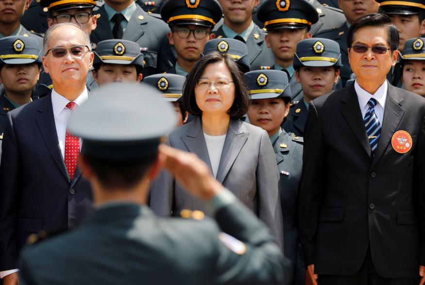 A soldier salutes (L-R) Director of the Institute for National Security Studies Feng Shih-kuan, Taiwanese President Tsai Ing-wen, and Minister of National Defense Yen Teh-fa afterthe joint military academies graduation ceremony, in Taipei, Taiwan June 29,