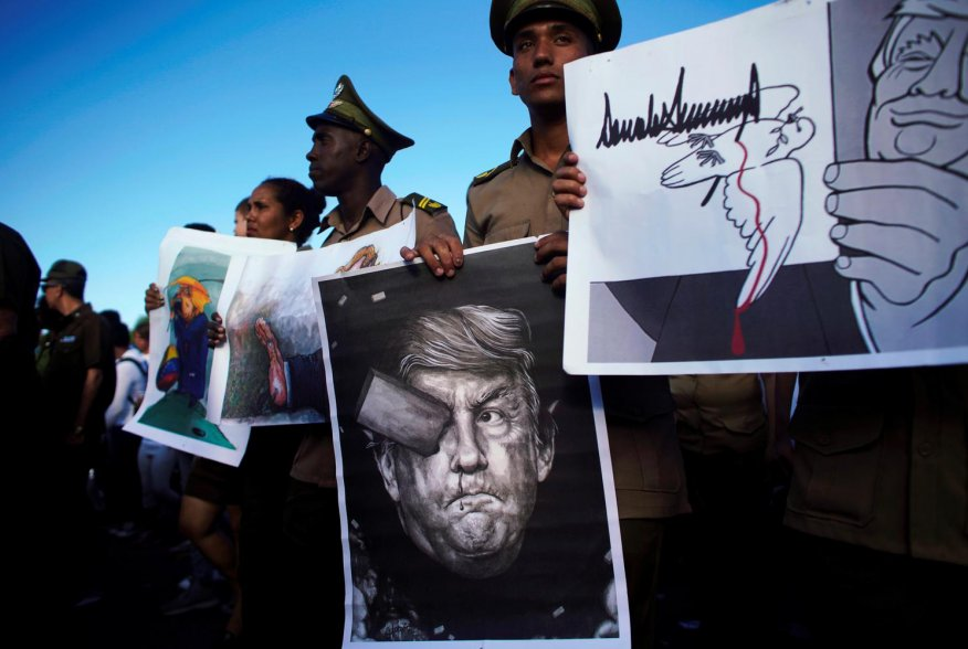 Cuban soldiers carry images depicting U.S. President Donald Trump during a May Day rally in Havana, Cuba May 1, 2019. REUTERS/Alexandre Meneghini