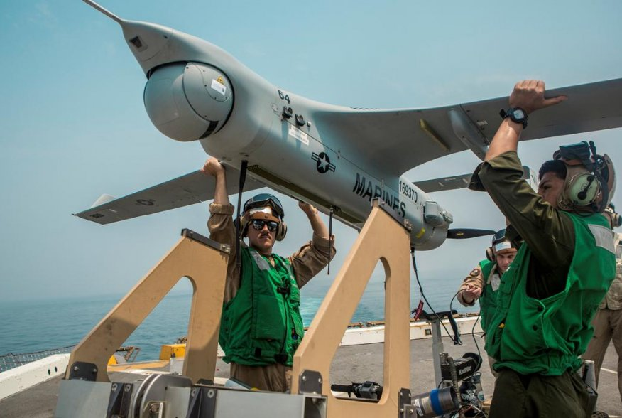 U.S. Navy Marines lift an RQ-21A Blackjack unmanned aerial system (UAS) onto a launcher before flight operations aboard the amphibious transport dock ship USS John P. Murtha (LPD 26) in the Gulf, in this undated handout picture released by U.S. Navy on Ju
