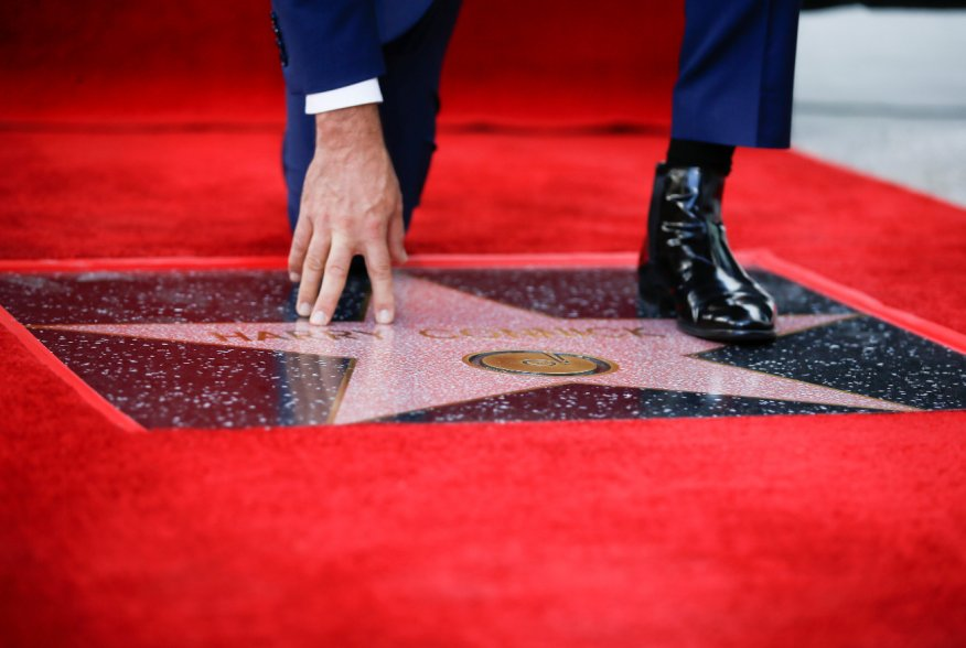 Entertainer Harry Connick Jr. touches his star during his Hollywood Walk of Fame star ceremony in Los Angeles, California, U.S., October 24, 2019. REUTERS/Danny Moloshok