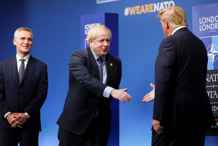 NATO Secretary General Jens Stoltenberg and Britain's Prime Minister Boris Johnson greet U.S. President Donald Trump at the annual NATO heads of government summit at the Grove hotel in Watford, Britain December 4, 2019. REUTERS/Peter Nicholls/Pool