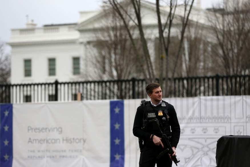 FILE PHOTO: A Secret Service agent stands guard outside the White House in Washington, U.S., January 3, 2020. REUTERS/Leah Millis/File Photo