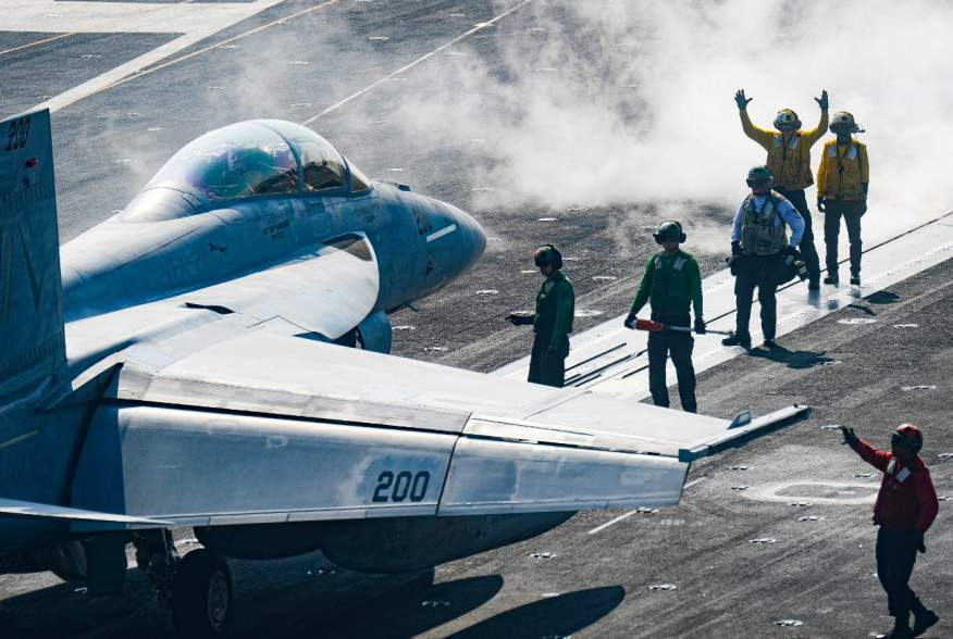 Sailors carry out pre-flight checks on an F/A-18F Super Hornet on the flight deck of the U.S. Navy aircraft carrier USS Harry S. Truman in the Arabian Sea January 6, 2020.