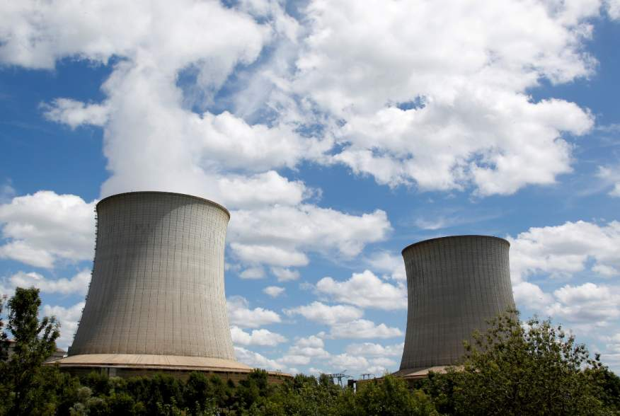 FILE PHOTO: Cooling towers of Electricite de France (EDF) nuclear plant are seen in Saint-Laurent-Des-Eaux near Orleans, France, June 17, 2019. REUTERS/ Regis Duvignau/File Photo