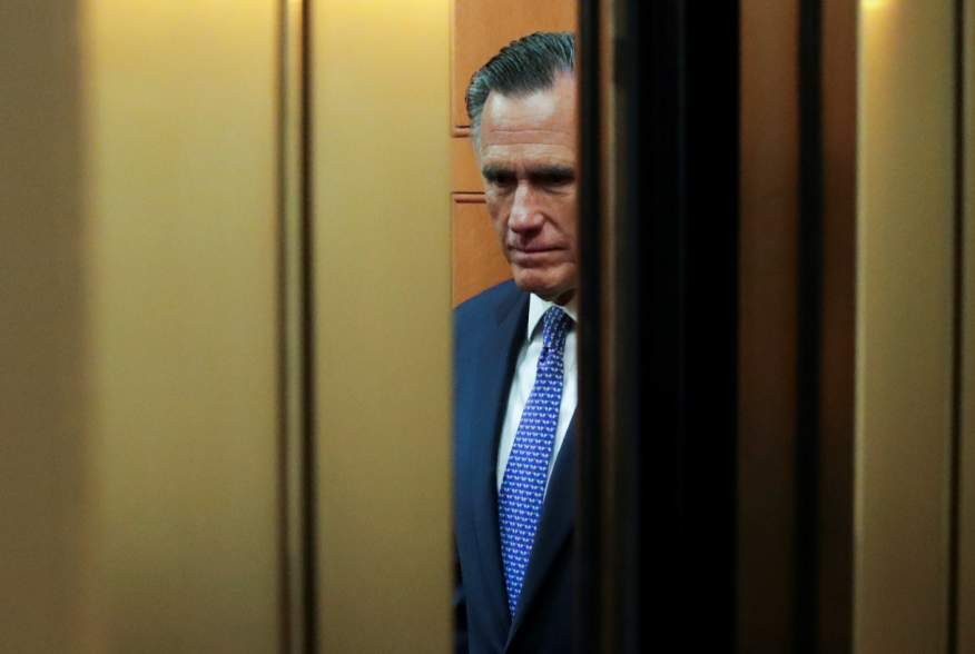 U.S. Senator Mitt Romney (R-UT) rides in a U.S. Capitol elevator to the U.S. Senate floor to cast a guilty vote during the final votes in the Senate impeachment trial of U.S. President Donald Trump on Capitol Hill in Washington, U.S., February 5, 2020. RE