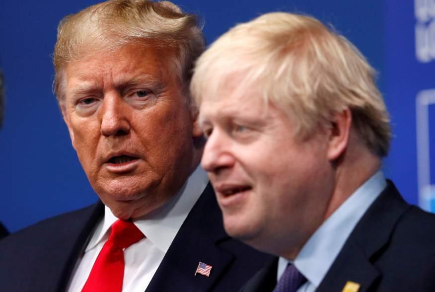 FILE PHOTO: Britain's Prime Minister Boris Johnson welcomes U.S. President Donald Trump at the NATO leaders summit in Watford, Britain December 4, 2019. REUTERS/Peter Nicholls/File Photo