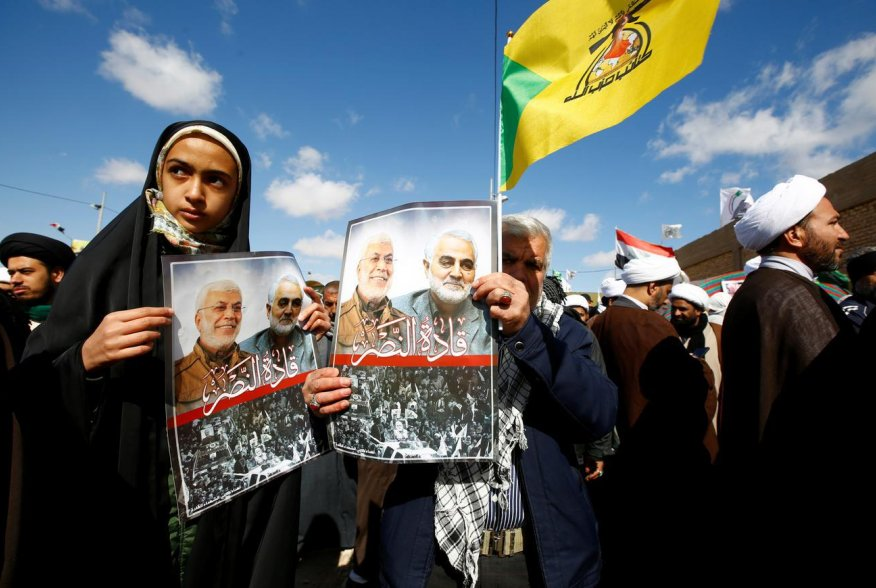 "Iranian people carry pictures of the late Iran's Quds Force top commander Qassem Soleimani and Iraqi militia commander Abu Mahdi al-Muhandis, who were killed in a U.S. airstrike at Baghdad airport, during the forty days memorial at the ""Valley of Peace"" c"