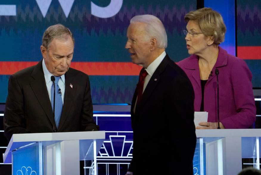 Former Vice President Joe Biden walks past former New York City Mayor Mike Bloomberg and Senator Elizabeth Warren during a break at the ninth Democratic 2020 U.S. Presidential candidates debate at the Paris Theater in Las Vegas, Nevada, U.S., February 19,