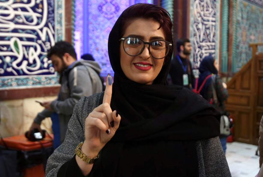 A woman shows her ink-stained finger after she casted her vote during parliamentary elections at a polling station in Tehran, Iran February 21, 2020. Nazanin Tabatabaee/WANA (West Asia News Agency) via REUTERS