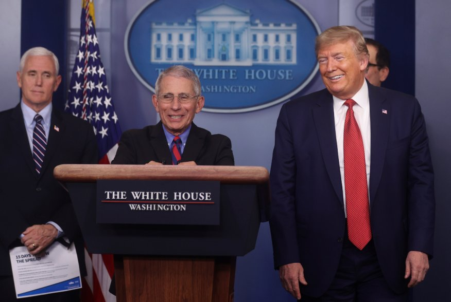 Dr. Anthony Fauci, Director of the National Institute of Allergy and Infectious Diseases, smiles as he addresses the coronavirus task force daily briefing with Vice President Mike Pence and President Donald Trump at the White House in Washington, U.S., Ma
