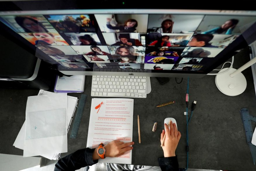 A student takes classes online with his companions using the Zoom APP at home during the coronavirus disease (COVID-19) outbreak in El Masnou, north of Barcelona, Spain April 2, 2020. REUTERS/ Albert Gee