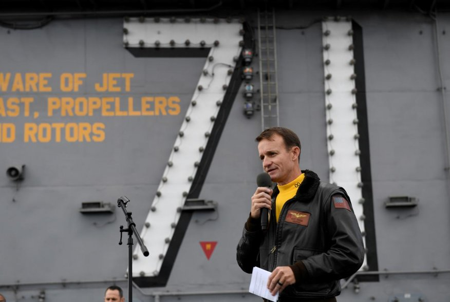 Captain Brett Crozier, commanding officer of the U.S. Navy aircraft carrier USS Theodore Roosevelt, addresses the crew during an all-hands call on the ship's flight deck in the eastern Pacific Ocean December 19, 2019. Picture taken December 19, 2019. U.S.