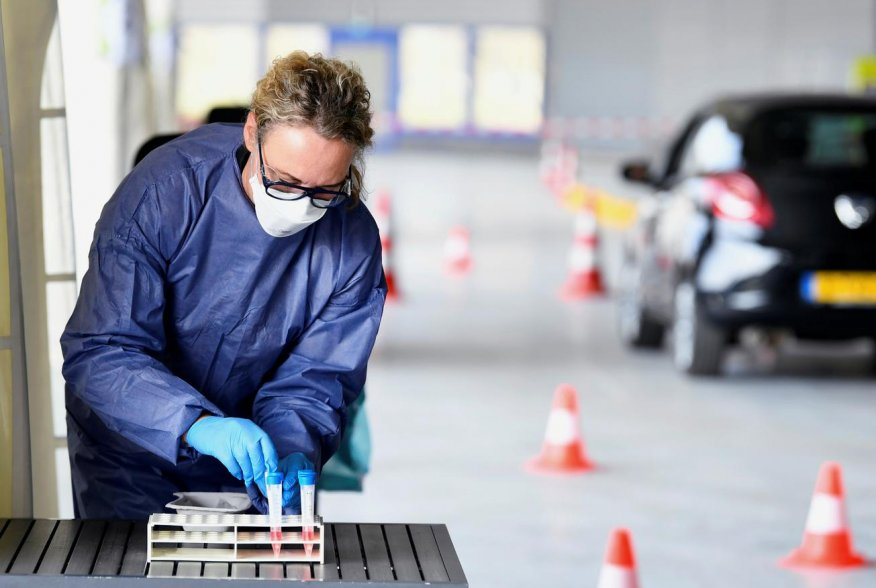 A member of medical staff takes coronavirus test samples during drive-thru coronavirus disease (COVID-19) testing, on a converted ice rink, in Alkmaar, Netherlands April 8, 2020. REUTERS/Piroschka van de Wouw