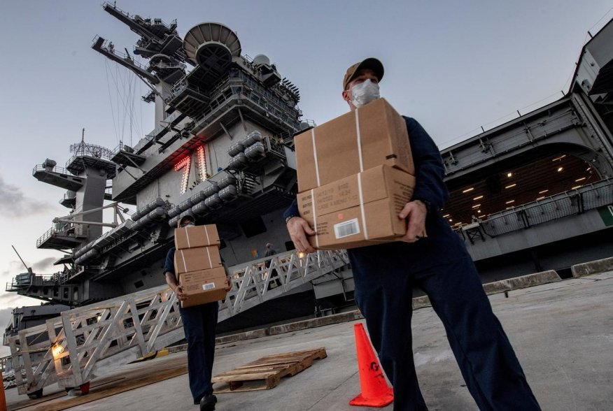 U.S. Navy sailors assigned to the aircraft carrier USS Theodore Roosevelt move meals, ready to eat (MREs) for sailors who have tested negative for coronavirus disease (COVID-19) and are asymptomatic while quarantined at local hotels in an effort to implem