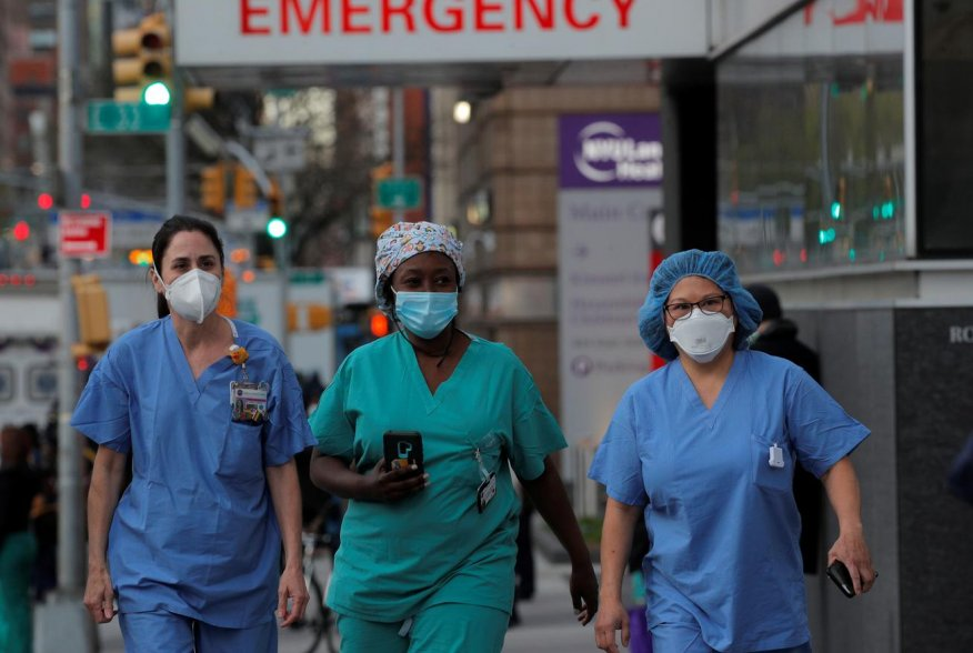 Healthcare workers walk outside NYU Langone Medical Center on 1st Avenue in Manhattan after people came to cheer and thank them, during the outbreak of the coronavirus disease (COVID-19) in New York City, New York, U.S., April 20, 2020. REUTERS/Brendan Mc