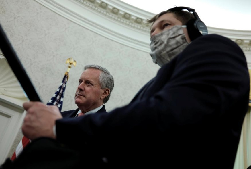 White House Acting Chief of Staff Mark Meadows listens next to a masked soundman and member of the news media during U.S. President Donald Trump's coronavirus response meeting with New Jersey Governor Phil Murphy in the Oval Office at the White House in W