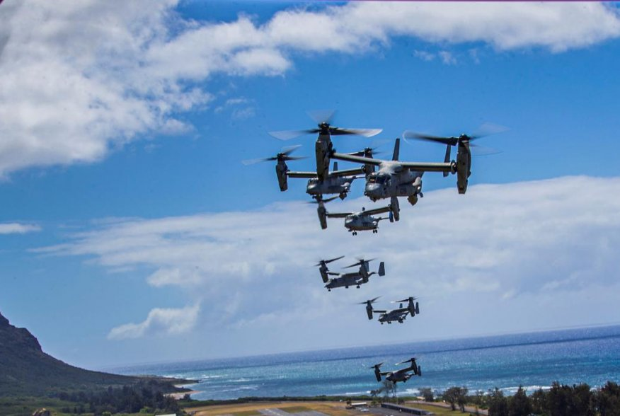 A flight of U.S. Marines MV-22B Osprey transport aircraft fly in formation during an integrated training mission at Marine Corps Air Station Kaneohe Bay near Kailua, Hawaii, U.S. May 19, 2020. Picture taken May 19, 2020. U.S. Marine Corps/Lance Cpl. Jacob