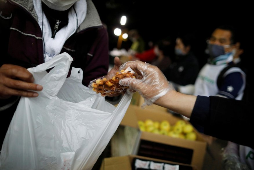 An elderly man receives food aid handouts for the needy, as the spread of the coronavirus disease (COVID-19) continues in Tokyo, Japan, May 9, 2020. Picture taken May 9, 2020. REUTERS/Issei Kato