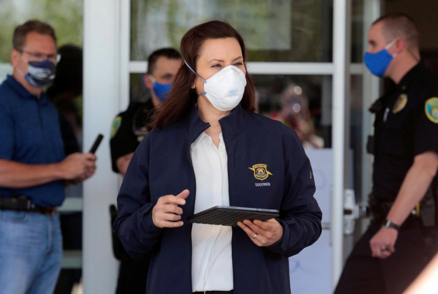 Michigan Governor Gretchen Whitmer wears a face mask as she arrives to address the media about the flooding along the Tittabawassee River, after several dams breached, in downtown Midland, Michigan U.S., May 20, 2020. REUTERS/Rebecca Cook