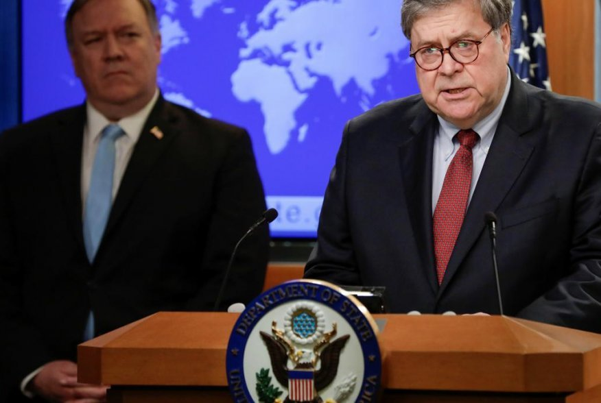 U.S. Attorney General Bill Barr speaks as Secretary of State Mike Pompeo listens during a joint briefing about an executive order from U.S. President Donald Trump on the International Criminal Court at the State Department in Washington, U.S., June 11, 20