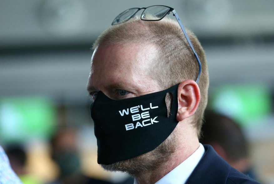 Lufthansa employee wearing face a mask takes part in a protest against the reduction of the number of jobs due to the outbreak of the coronavirus disease (COVID-19), at the airport in Frankfurt, Germany, June 19, 2020. REUTERS/Ralph Orlowski