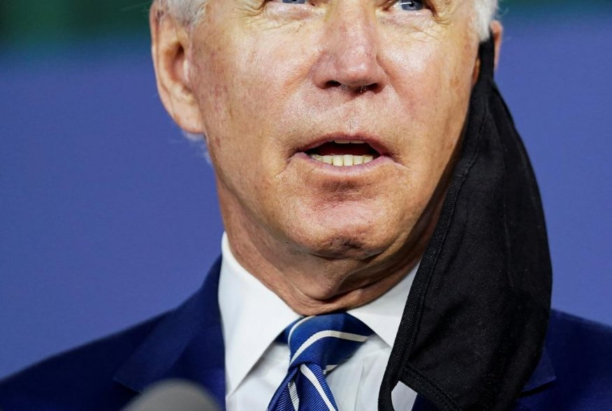 With a face mask hanging off his ear, Democratic U.S. presidential candidate and former Vice President Joe Biden speaks about the third part of his four-part economic recovery plan to revive the coronavirus-battered U.S. economy during a campaign event in
