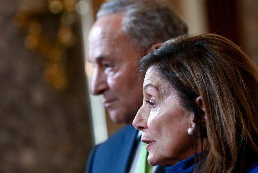 U.S. Speaker of the House Nancy Pelosi, joined by Senate Minority Leader Chuck Schumer, speaks to reporters in the U.S. Capitol in Washington, U.S. July 29, 2020. REUTERS/Erin Scott