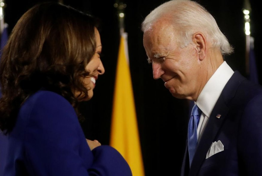 Democratic presidential candidate and former Vice President Joe Biden and vice presidential candidate Senator Kamala Harris are seen at the stage during a campaign event, their first joint appearance since Biden named Harris as his running mate, at Alexis