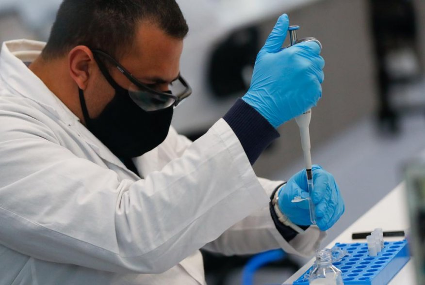 A laboratory technician of biotechnology company mAbxience is seen working, amid the outbreak of the coronavirus disease (COVID-19), in Buenos Aires, Argentina August 13, 2020. REUTERS/Agustin Marcarian