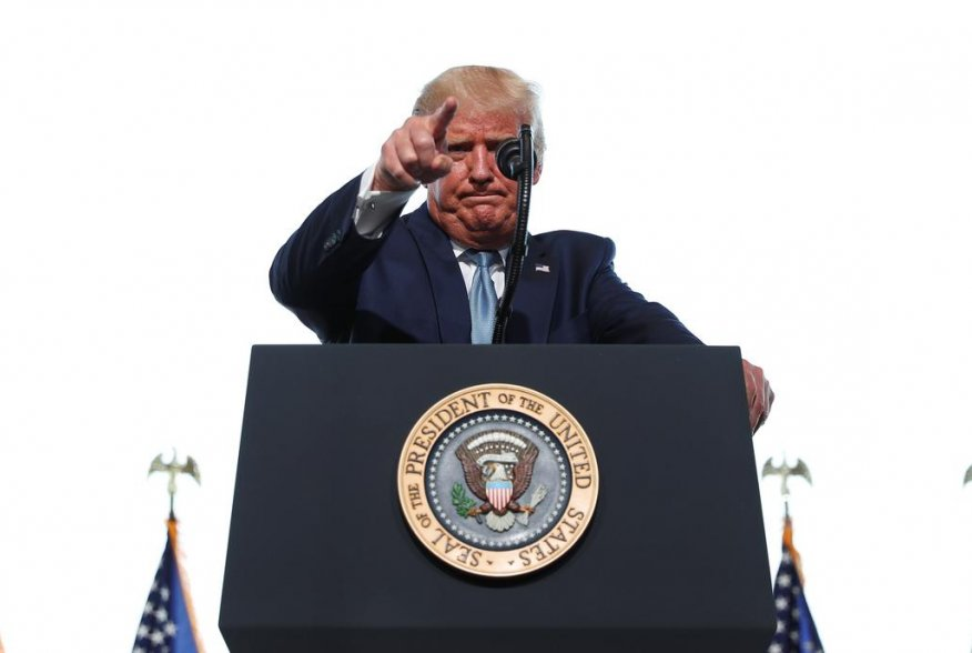 U.S. President Donald Trump points as he delivers remarks during a campaign event at Yuma International Airport in Yuma, Arizona, U.S., August 18, 2020. REUTERS/Tom Brenner